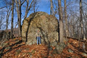 Andy Brodeur in front of a  pillow basalt glacial erratic  on the M&M Trail on Mount Tom in western Massachusetts. The site is not far from The Trustees of Reservations Dinosaur Footprints site on the Connecticut River between Holyoke and Northampton.